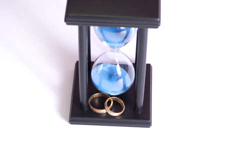 Sand clock and wedding rings