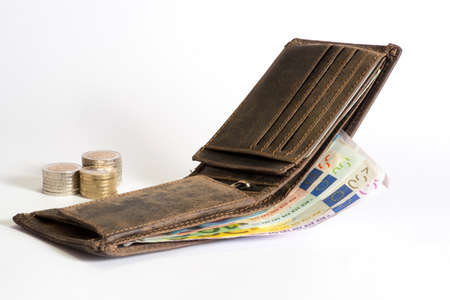 A wallet, euro money and coins Stock Photo