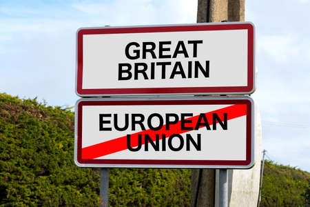 United Kingdom and Gibraltar European Union membership referendum and a traffic sign for Great Britain and European Union Foto de archivo