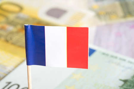 indebtedness: Flag of france and euro money
