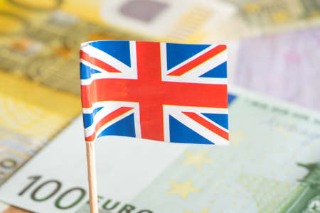 gb pound: Euro money and flag of the great britain Stock Photo