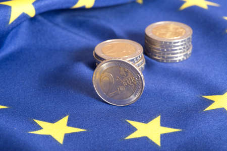 indebtedness: European union flag and euro coin