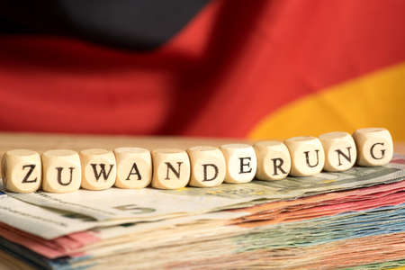 indebtedness: Euro money, german flag and immigration