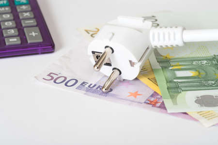 current account: Euro money, calculator and power strip