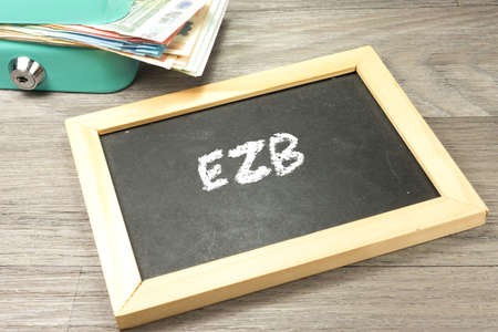 A cashbox and a chalkboard with the word ECB