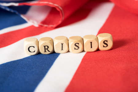 Flag of Great Britain and the word Crisis Banco de Imagens