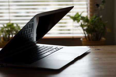 A laptop on a table in the office Stock Photo