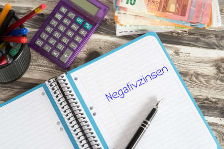 Euro banknotes, calculator and negative interest rates