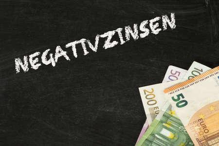 Euro banknotes and the negative interest rates Foto de archivo