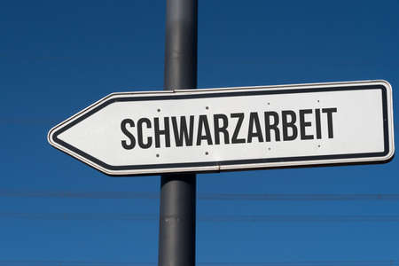 A signpost with the imprint Schwarzarbeit