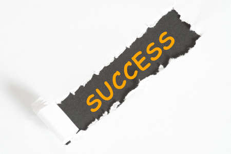 A piece of paper and the word success Stock Photo