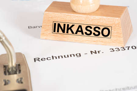 An invoice and a stamp with the imprint Inkasso