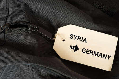 A travel bag and immigration from Syria to Germany Stockfoto