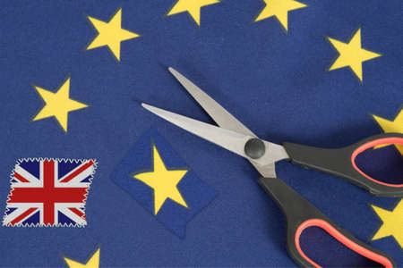 Flag of the EU and Great Britain, scissors and Brexit