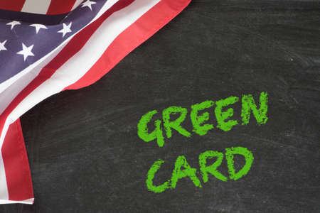 Flag of the USA and the Green Card Stockfoto