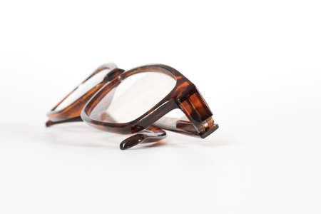 A pair of glasses on a light background Imagens