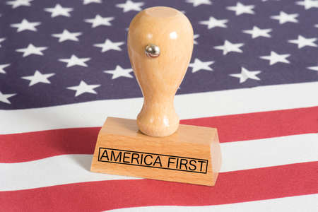 Flag of the USA and a stamp with the imprint America First