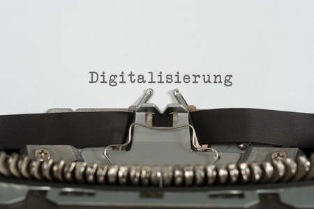 An old typewriter and the word digitization Imagens - 97392939