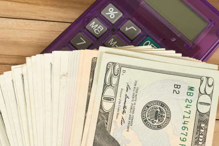 American dollars and a calculator Stock Photo