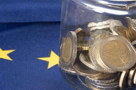 Flag of the European Union EU and coins in a mason jar Stock Photo