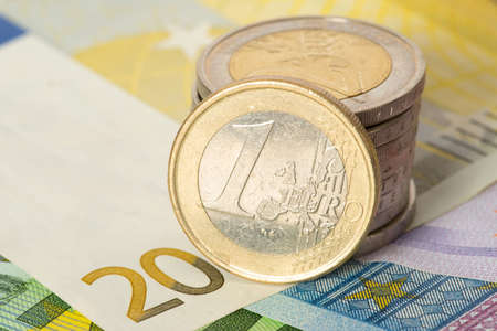 Euro coins and Euro bills Stock Photo