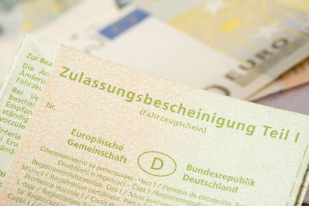 A vehicle registration and euro banknotes Stok Fotoğraf - 98794981