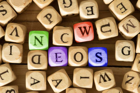Many wooden letters and the word News