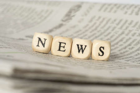 A newspaper and the word news