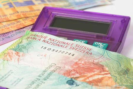 A calculator and Swiss Franc