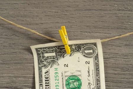 A dollar bill on a clothesline