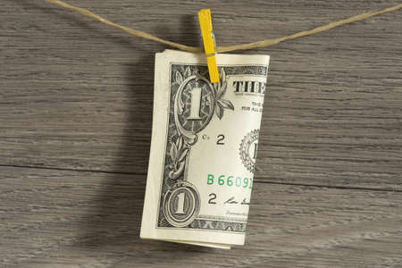 A dollar bill and a clothespin