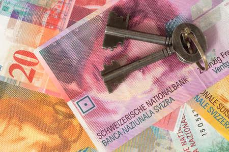A house key and cash Swiss francs Stock fotó - 97879563
