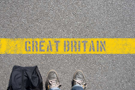A man with a suitcase is on the border with Great Britain