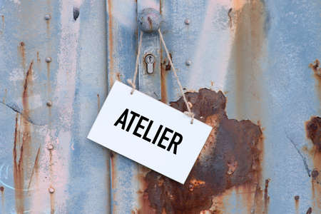 An old, rusty door and a sign indicating a studio 스톡 콘텐츠