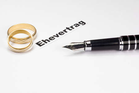 A marriage contract, wedding rings and a fountain pen