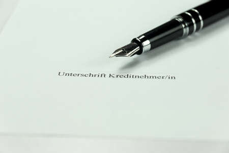 A pen and signature on a credit agreement Reklamní fotografie