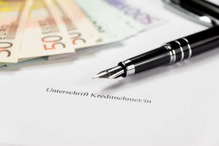 Signature on a loan agreement and cash