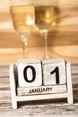 Champagne or champagne in the glass and a calendar on New Year's Eve