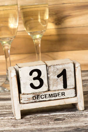 Champagne or sparkling wine and a calendar at the turn of the year