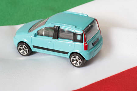 A car and the flag of Italy