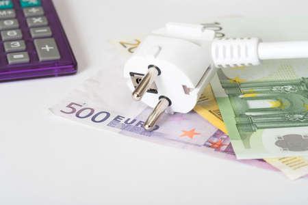 An electric plug and euro bills Stock Photo