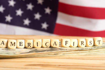 American flag, dollar bills and slogan America First 写真素材 - 100071816