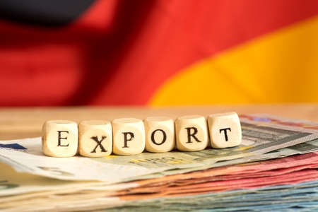 German flag, euro bills and the word export