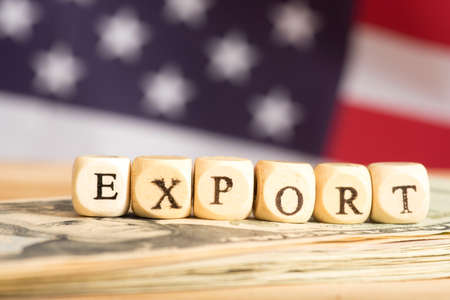 Flag of the USA, dollar bills and the word export