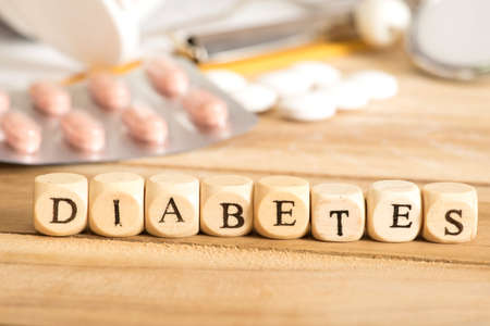Various tablets and the word Diabetes Stock Photo