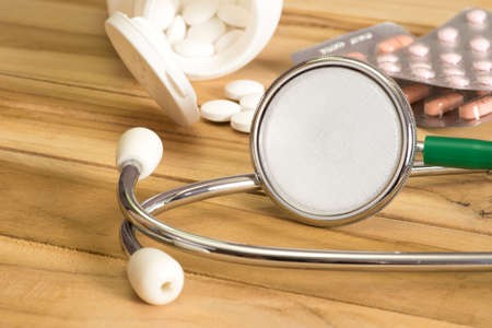A stethoscope and different tablets