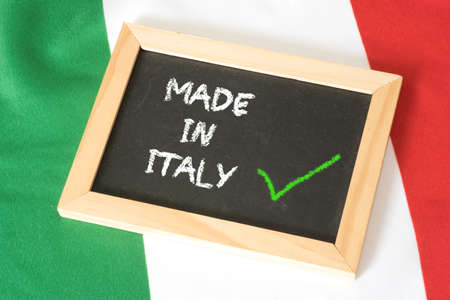 Italian flag and a chalk board with the slogan Made in Italy