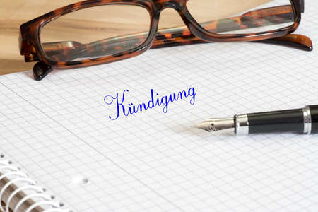 A handwritten cancellation, glasses and a pen