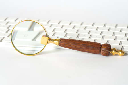 A magnifying glass and a computer