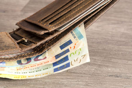 A wallet and euro bills